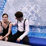 SOCHI, RUSSIA - FEBRUARY 08:  Anna Cappellini and Luca Lanotte of Italy look on after competing in the Figure Skating Team Ice Dance - Short Dance during day one of the Sochi 2014 Winter Olympics at Iceberg Skating Palace on February 8, 2014 in Sochi, Russia.  (Photo by Darren Cummings/Pool/Getty Images)