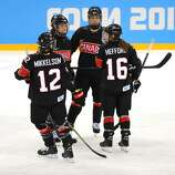 SOCHI, RUSSIA - FEBRUARY 08:  Jayna Hefford #16 of Canada talks with her teammates against Switzerland during the Women's Ice Hockey Preliminary Round Group A Game on day 1 of the Sochi 2014 Winter Olympics at Shayba Arena on February 8, 2014 in Sochi, Russia.  (Photo by Martin Rose/Getty Images)