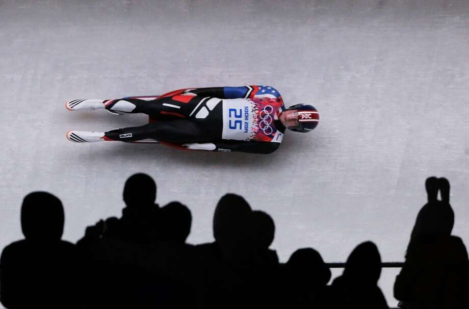 SOCHI, RUSSIA - FEBRUARY 08:  Tucker West of the United States makes a run during the Luge Men's Singles on Day 1 of the Sochi 2014 Winter Olympics at the Sliding Center Sanki on February 8, 2014 in Sochi, Russia.  (Photo by Adam Pretty/Getty Images) Photo: Getty Images