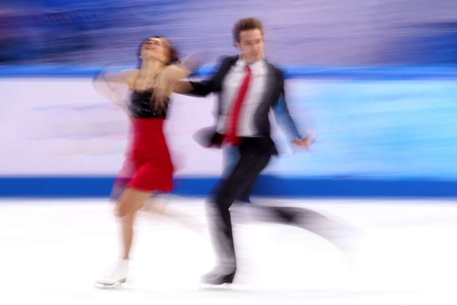 SOCHI, RUSSIA - FEBRUARY 08:  Nathalie Pechalat and Fabian Bourzat of France compete in the Figure Skating Team Ice Dance - Short Dance during day one of the Sochi 2014 Winter Olympics at Iceberg Skating Palace on February 8, 2014 in Sochi, Russia.  (Photo by Streeter Lecka/Getty Images) Photo: Getty Images