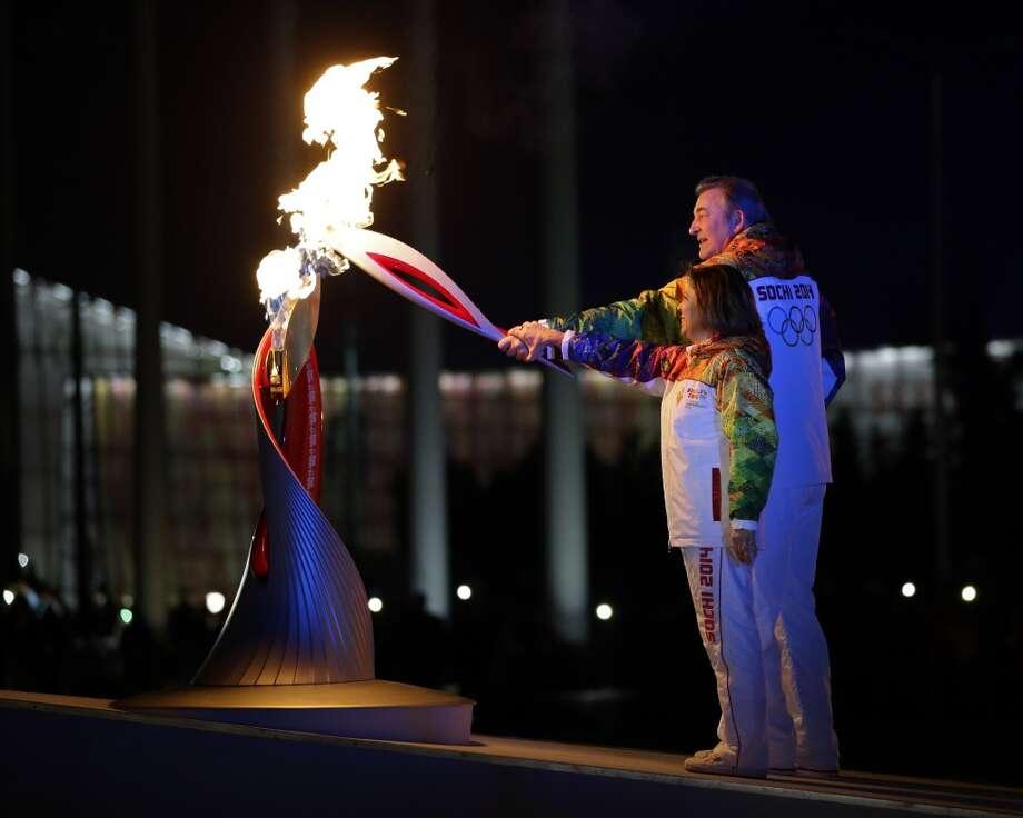 Irina Rodnina and Vladislav Tretiak light the Olympic cauldron during the opening ceremony of the 2014 Winter Olympics in Sochi, Russia, Friday, Feb. 7, 2014. (AP Photo/Matt Slocum, Pool) Photo: Associated Press