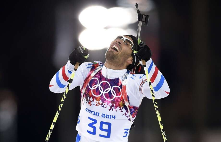 France's Martin Fourcade reacts as he competes in the Men's Biathlon 10 km Sprint at the Laura Cross-Country Ski and Biathlon Center during the Sochi Winter Olympics on February 8, 2014 in Rosa Khutor. AFP PHOTO / ODD ANDERSENODD ANDERSEN/AFP/Getty Images Photo: AFP/Getty Images
