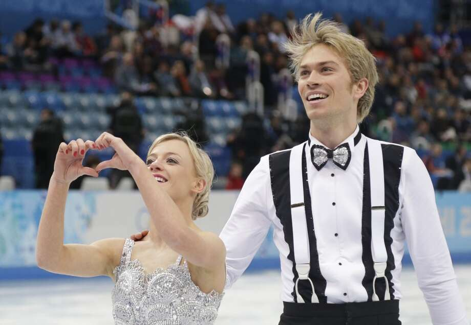 Germany's Nelli Zhiganshina and Germany's Alexander Gazsi react after performing the Figure Skating Team Ice Dance Short Dance at the Iceberg Skating Palace during the Sochi Winter Olympics on February 8, 2014.  AFP PHOTO / DARRON CUMMINGSDARRON CUMMINGS/AFP/Getty Images Photo: AFP/Getty Images