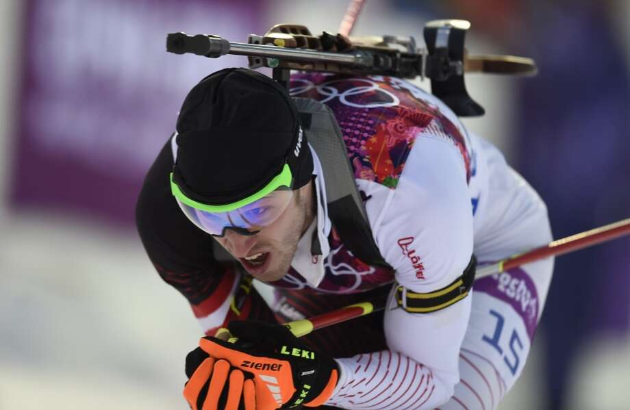 Austria's Dominik Landertinger competes in the Men's Biathlon 10 km Sprint at the Laura Cross-Country Ski and Biathlon Center during the Sochi Winter Olympics on February 8, 2014 in Rosa Khutor. AFP PHOTO / ODD ANDERSENODD ANDERSEN/AFP/Getty Images Photo: AFP/Getty Images