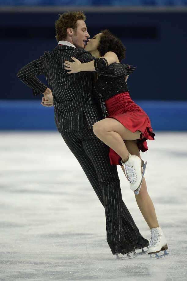 France's Fabian Bourzat and France's Nathalie Pechalat perform in the Figure Skating Team Ice Dance Short Dance at the Iceberg Skating Palace during the Sochi Winter Olympics on February 8, 2014.  AFP PHOTO / ALEXANDER NEMENOVALEXANDER NEMENOV/AFP/Getty Images Photo: AFP/Getty Images