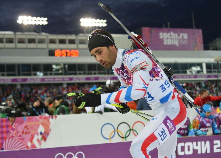 France's Martin Fourcade competes in the Men's Biathlon 10 km Sprint at the Laura Cross-Country Ski and Biathlon Center during the Sochi Winter Olympics on February 8, 2014 in Rosa Khutor. AFP PHOTO / ALBERTO PIZZOLIALBERTO PIZZOLI/AFP/Getty Images Photo: AFP/Getty Images