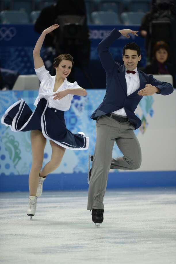 Italy's Anna Cappellini and Italy's Marco Fabbri perform in the Figure Skating Team Ice Dance Short Dance at the Iceberg Skating Palace during the Sochi Winter Olympics on February 8, 2014. AFP PHOTO / ALEXANDER NEMENOVALEXANDER NEMENOV/AFP/Getty Images Photo: AFP/Getty Images