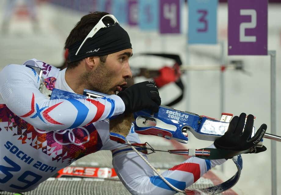 France's Martin Fourcade shoots at the range as he competes in the Men's Biathlon 10 km Sprint at the Laura Cross-Country Ski and Biathlon Center during the Sochi Winter Olympics on February 8, 2014 in Rosa Khutor. AFP PHOTO / ALBERTO PIZZOLIALBERTO PIZZOLI/AFP/Getty Images Photo: AFP/Getty Images