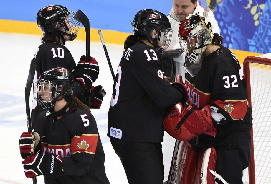 Canada's players celebrate at the end of the Women's Ice Hockey Group A match between Canada and Switzerland at the Shayba Arena during the Sochi Winter Olympics on February 8, 2014. Canada won 5-0.    AFP PHOTO / JONATHAN NACKSTRANDJONATHAN NACKSTRAND/AFP/Getty Images Photo: AFP/Getty Images