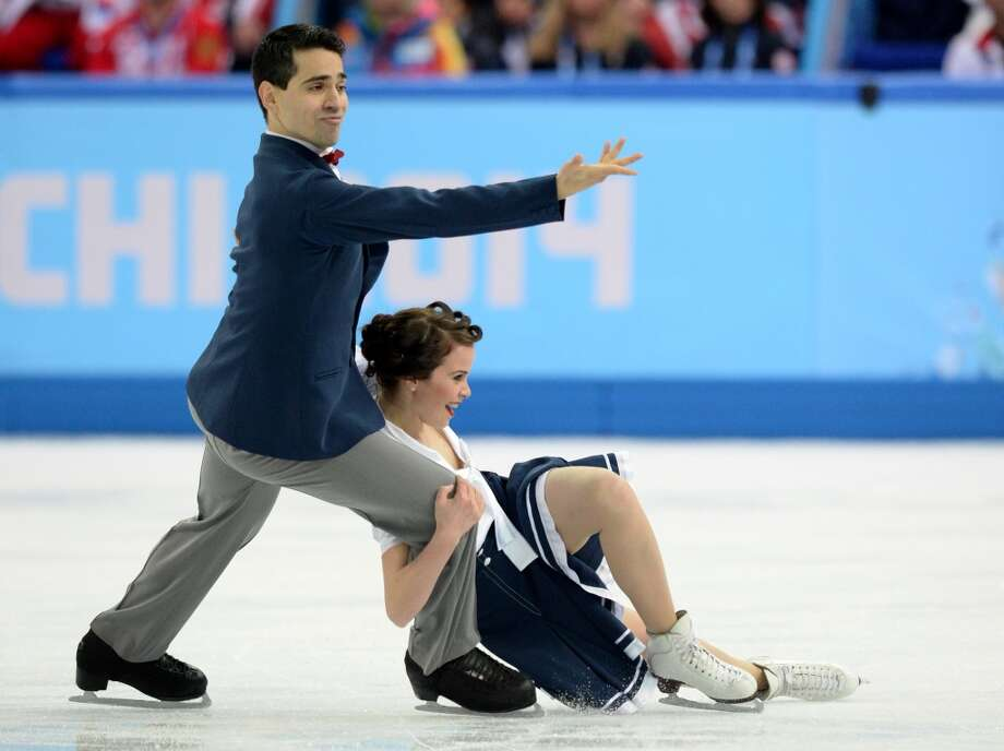 Italy's Anna Cappellini and Italy's Marco Fabbri perform in the Figure Skating Team Ice Dance Short Dance at the Iceberg Skating Palace during the Sochi Winter Olympics on February 8, 2014.     AFP PHOTO / YURI KADOBNOVYURI KADOBNOV/AFP/Getty Images Photo: AFP/Getty Images