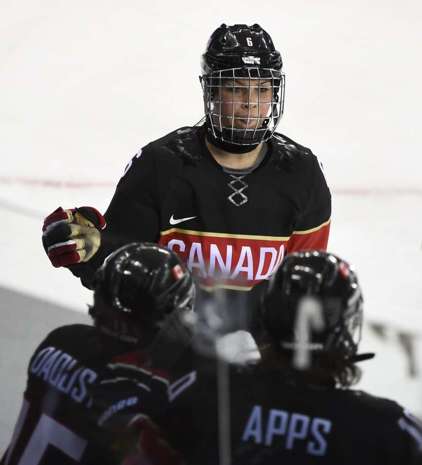 Canada's Rebecca Johnston celebrates after scoring during the Women's Ice Hockey Group A match Canada vs Switzerland at the Shayba Arena during the Sochi Winter Olympics on February 8, 2014. AFP PHOTO / JONATHAN NACKSTRANDJONATHAN NACKSTRAND/AFP/Getty Images Photo: AFP/Getty Images