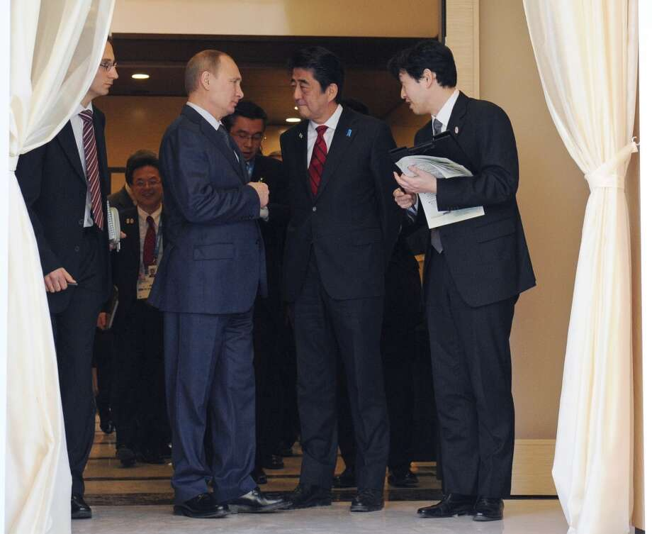 Russia's President Vladimir Putin meets with Japanese Prime Minister Shinzo Abe (2nd R) at the Bocharov Ruchei residence in Sochi, on February 8, 2014. AFP PHOTO / RIA-NOVOSTI / POOL / Mikhail KlimentievMIKHAIL KLIMENTIEV/AFP/Getty Images Photo: AFP/Getty Images