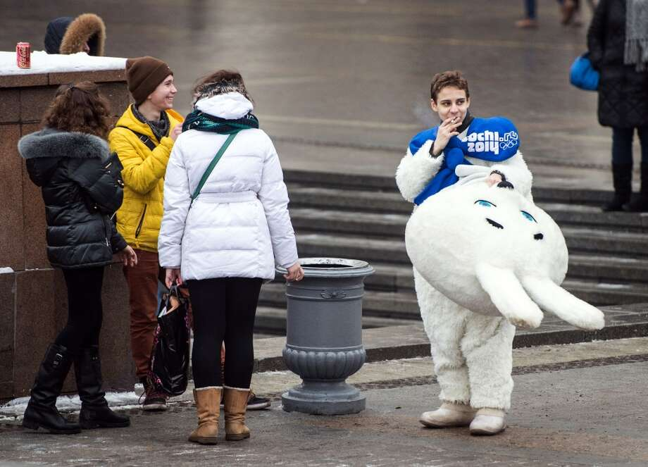 A street artist dressed as the white rabbit, one of the mascots of the 2014 Winter Sochi Olympics, smokes in the center of Moscow on February 8, 2014. AFP PHOTO / DMITRY SEREBRYAKOVDMITRY SEREBRYAKOV/AFP/Getty Images Photo: AFP/Getty Images