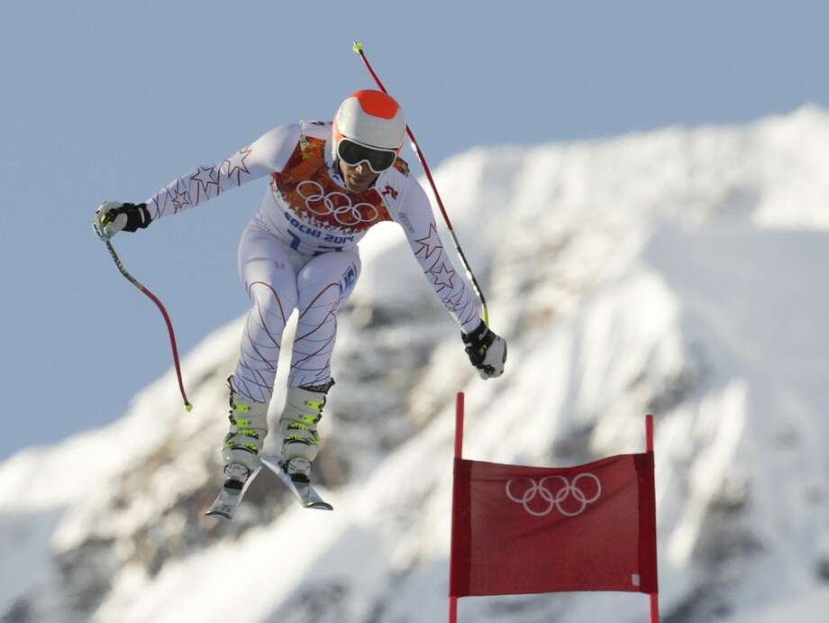 United States' Bode Miller makes a jump during a men's downhill training run for the Sochi 2014 Winter Olympics, Friday, Feb. 7, 2014, in Krasnaya Polyana, Russia. (AP Photo/Charles Krupa) Photo: Associated Press