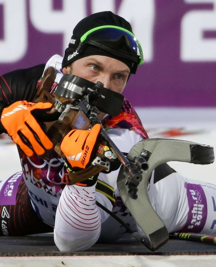 Austria's Dominik Landertinger prepares to shoot during the men's biathlon 10k sprint, at the 2014 Winter Olympics, Saturday, Feb. 8, 2014, in Krasnaya Polyana, Russia. Austria's Dominik Landertinger clinched the silver. (AP Photo/Gero Breloer) Photo: Associated Press
