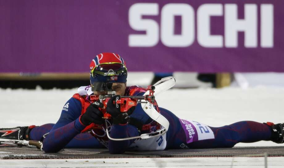 Norway's Ole Einar Bjoerndalen shoots on his way to win the gold medal in the men's biathlon 10k sprint, at the 2014 Winter Olympics, Saturday, Feb. 8, 2014, in Krasnaya Polyana, Russia. (AP Photo/Gero Breloer) Photo: Associated Press