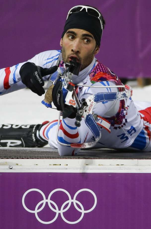 France's Martin Fourcade prepares to shoot during the men's biathlon 10k sprint, at the 2014 Winter Olympics, Saturday, Feb. 8, 2014, in Krasnaya Polyana, Russia. (AP Photo/Gero Breloer) Photo: Associated Press