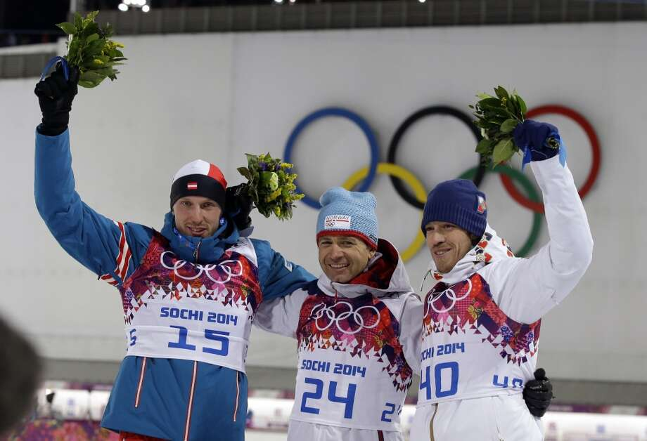 Norway's Ole Einar Bjoerndalen, center, winner of the men's biathlon 10k sprint, celebrates with silver medalist Austria's Dominik Landertinger, left, and bronze medalist Czech Republic's Jaroslav Soukup, at the 2014 Winter Olympics, Saturday, Feb. 8, 2014, in Krasnaya Polyana, Russia. (AP Photo/Lee Jin-man) Photo: Associated Press