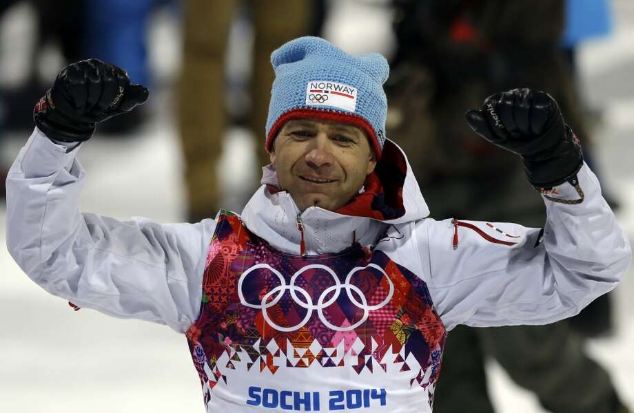 Norway's Ole Einar Bjoerndalen celebrates after clinching the gold medal in the men's biathlon 10k sprint, at the 2014 Winter Olympics, Saturday, Feb. 8, 2014, in Krasnaya Polyana, Russia. (AP Photo/Kirsty Wigglesworth) Photo: Associated Press