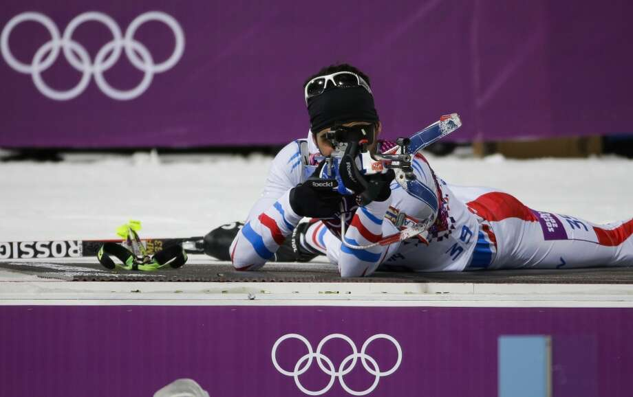 France's Martin Fourcade shoots during the men's biathlon 10k sprint, at the 2014 Winter Olympics, Saturday, Feb. 8, 2014, in Krasnaya Polyana, Russia. (AP Photo/Gero Breloer) Photo: Associated Press