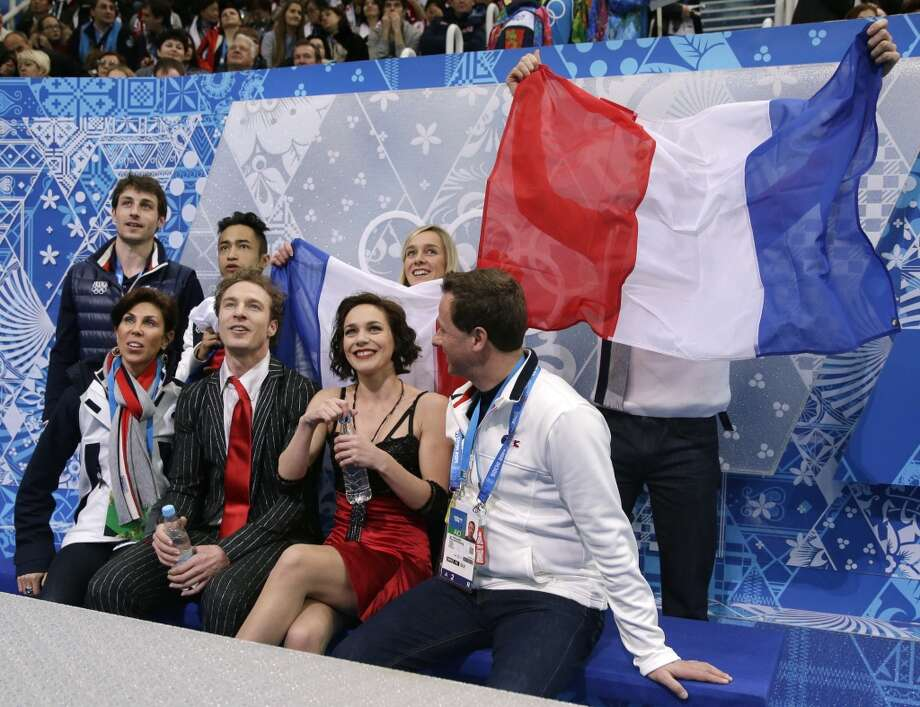 Nathalie Pechalat and Fabian Bourzat of France wait for their results after competing in the team ice dance short dance figure skating competition at the Iceberg Skating Palace during the 2014 Winter Olympics, Saturday, Feb. 8, 2014, in Sochi, Russia. (AP Photo/Darron Cummings, Pool) Photo: Associated Press