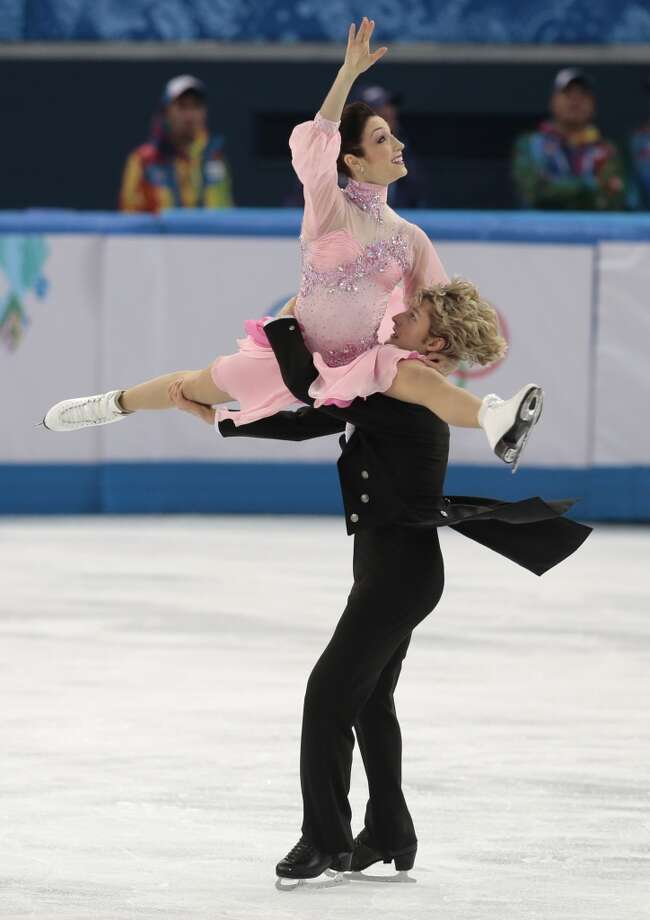 Meryl Davis and Charlie White of the United States compete in the team ice dance short dance figure skating competition at the Iceberg Skating Palace during the 2014 Winter Olympics, Saturday, Feb. 8, 2014, in Sochi, Russia. (AP Photo/Ivan Sekretarev) Photo: Associated Press