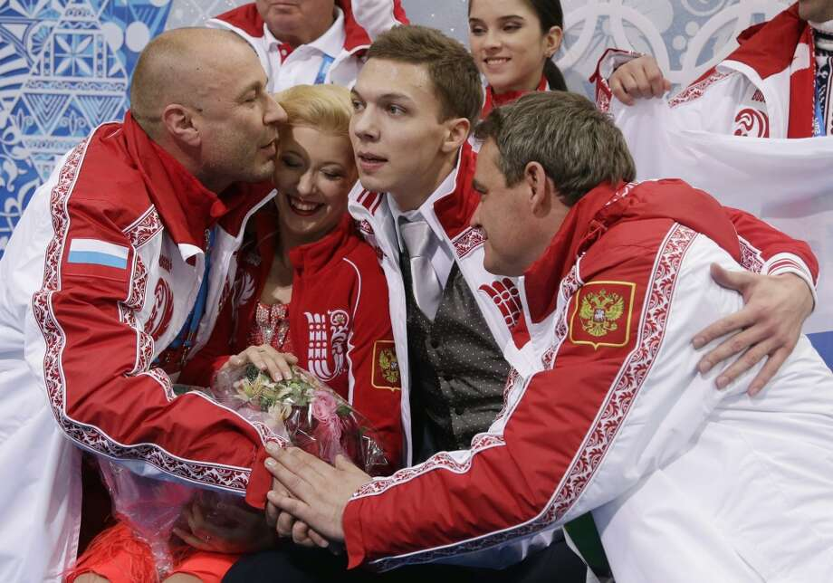 Ekaterina Bobrova and Dmitri Soloviev of Russia wait for their results after competing in the team ice dance short dance figure skating competition at the Iceberg Skating Palace during the 2014 Winter Olympics, Saturday, Feb. 8, 2014, in Sochi, Russia. (AP Photo/Darron Cummings, Pool) Photo: Associated Press