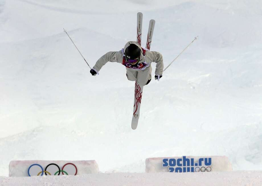 Australia's Nicole Parks jumps during women's moguls qualifying at the Rosa Khutor Extreme Park, at the 2014 Winter Olympics, Saturday, Feb. 8, 2014, in Krasnaya Polyana, Russia. (AP Photo/Andy Wong) Photo: Associated Press