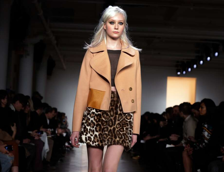 """Animal KingdomBCBGMAXAZARIA had fun with shearling on everything from coats to panels on tunics. Peter Som embraced leopard prints and feathers while Jason Wu featured fox jackets and fur handbags. Nicholas K's vaguely """"Nanook of the North"""" headgear was an extreme embrace of the trend.Pictured: The Peter Som Fall 2014 collection is modeled during Fashion Week in New York,  Friday, Feb. 7, 2014. (AP Photo/Richard Drew) Photo: Richard Drew, Associated Press"""