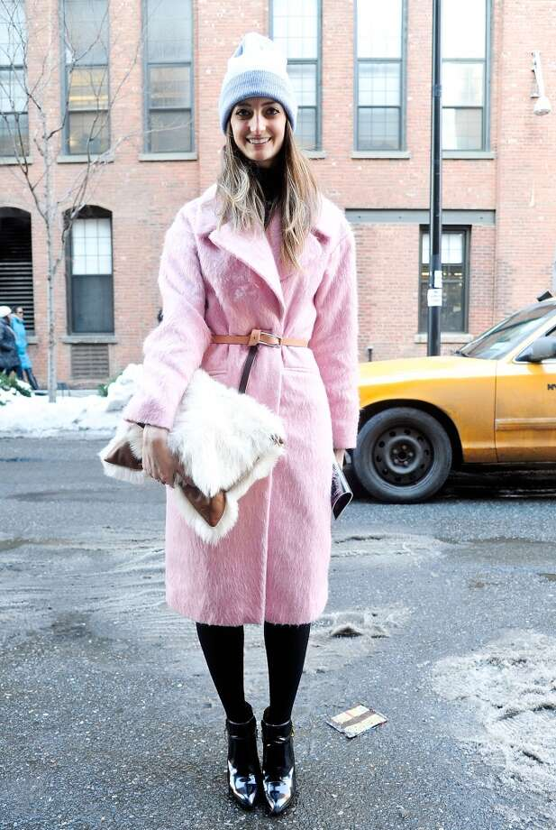 Associate market editor at Lucky Magazine Noelle Sciacca is seen outside the Costello Tagliapietra show wearing an ASOS coat, American Apparel beanie, Neil Barrett clutch and Zara boots on February 6, 2014 in New York City.  (Photo by Daniel Zuchnik/Getty Images) Photo: Daniel Zuchnik, Getty Images