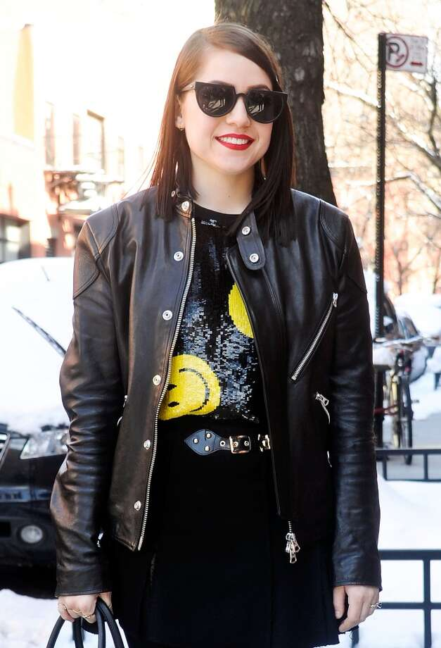 Stylist Jessica Bobince is seen outside the Duckie Brown show wearing an Acne jacket, Ashish sequin sweater, Zara skirt, Doc Martens boots, Prada bag and Henry Holland sunglasses on February 6, 2014 in New York City.  (Photo by Daniel Zuchnik/Getty Images) Photo: Daniel Zuchnik, Getty Images