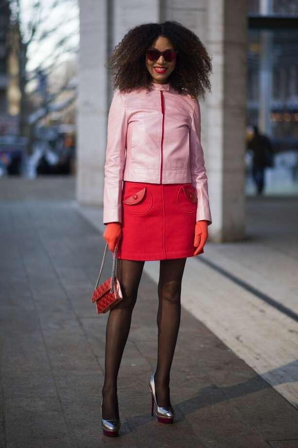 Ndoema is wearing a jacket from Prada, skirt and clutch from Marc Jacobs, shoes from TopShop and vintage glasses on the streets of Manhattan on February 7, 2014 in New York City.  (Photo by Timur Emek/Getty Images) Photo: Timur Emek, Getty Images