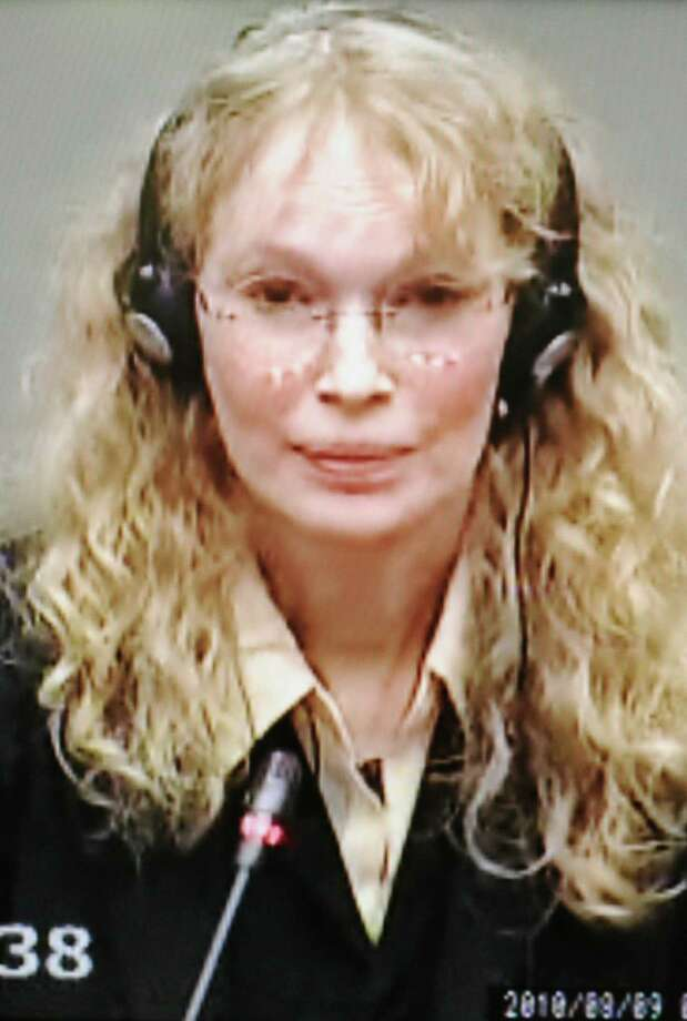 This photo taken of a monitor shows US actress Mia Farrow testifying before a war crimes trial in the Hague on August 9, 2010.  US actress Mia Farrow said today that Naomi Campbell had named Liberia's Charles Taylor as the man who sent a diamond to the supermodel's room in 1997. AFP PHOTO / MIGUEL MEDINA (Photo credit should read MIGUEL MEDINA/AFP/Getty Images)(Photo Credit should Read /AFP/Getty Images) Photo: MIGUEL MEDINA / MIGUEL MEDINA