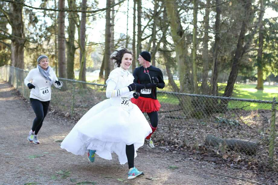 Katie Kory runs in a wedding dress during the Valentine's Day Dash 5K. Photo: JOSHUA TRUJILLO, SEATTLEPI.COM / SEATTLEPI.COM