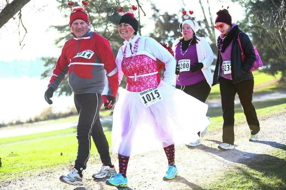 Participants run the course during the Valentine's Day Dash 5K. Photo: JOSHUA TRUJILLO, SEATTLEPI.COM / SEATTLEPI.COM