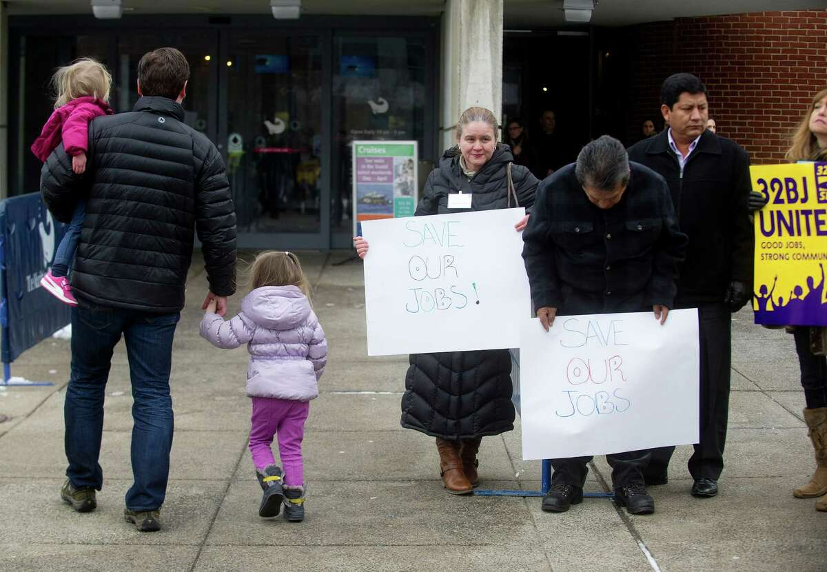 Families enter the Martitime Aquarium in Norwalk, Conn., as employees and 32BJ SEIU union members hold signs and chant outside to protest alleged unfair labor practices on Saturday, February 8, 2014.