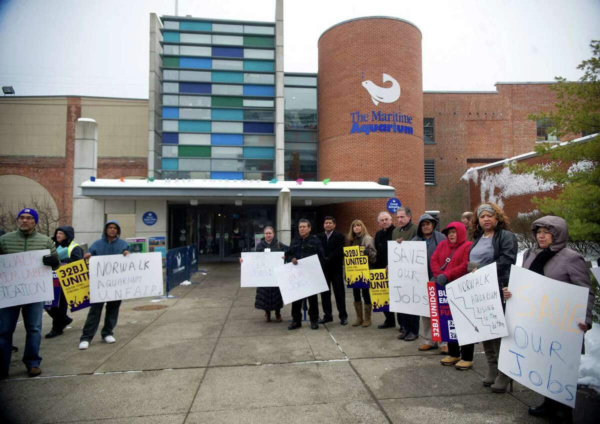 Employees and 32BJ SEIU union members hold signs and chant outside the Maritime Aquarium in Norwalk, Conn., to protest alleged unfair labor practices on Saturday, February 8, 2014.