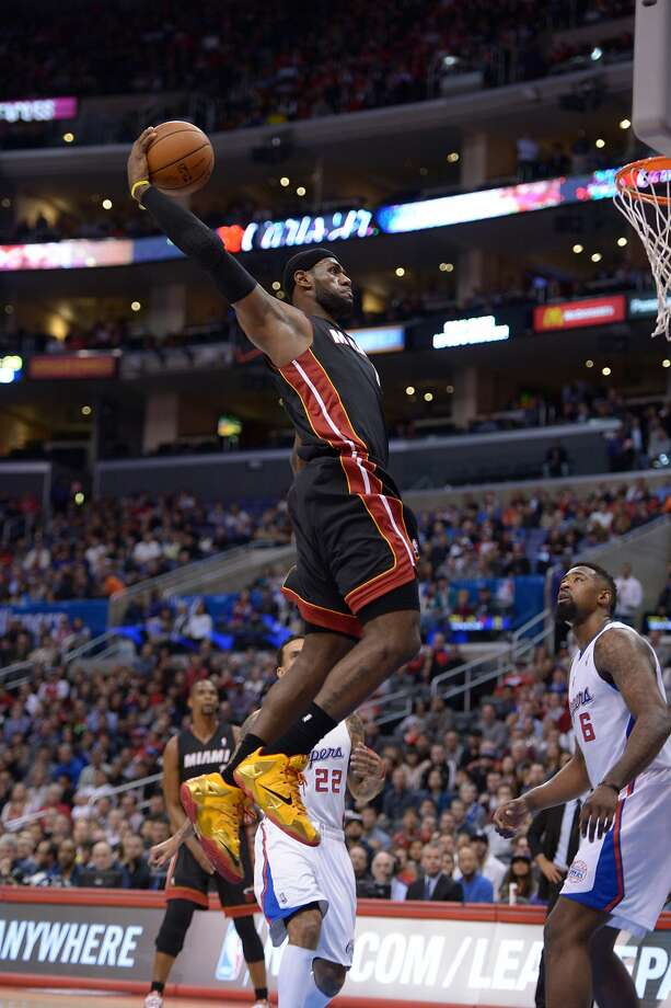 Miami's LeBron James dunks Wednesday on the Clippers - one of many teams linked to him through idle speculation. Photo: Kirby Lee, Reuters