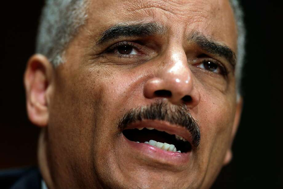 U.S. Attorney General Eric Holder says same-sex married couples will receive the same rights as opposite-sex spouses. Photo: Win McNamee, Getty Images