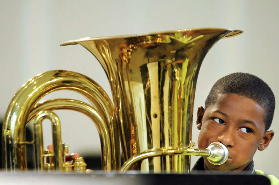 "Shaquore Caldwell, 13, of Albany plays Beethoven's ""Ode to Joy"" on the tuba with City Brass during the Empire State Youth Orchestras' annual Playathon on Saturday, Feb. 8, 2014, at Crossgates Mall in Guilderland, N.Y. Playathon, ESYOa€™s annual fundraiser, featuried free live music by ESYO musicians and was presented by Northeastern Fine Jewelry. (Cindy Schultz / Times Union) Photo: Cindy Schultz / 00025560A"