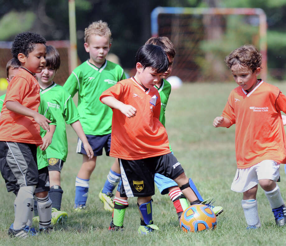 "At center, Brayden Senft, 5, of Greenwich, defends during the Town of Greenwich Department of Parks and Recreation's ""Saturday Indoor Soccer with Aldwin,""  a youth soccer program, at the Greenwich Civic Center, Saturday, Feb. 8, 2014. Photo: Bob Luckey / Greenwich Time"