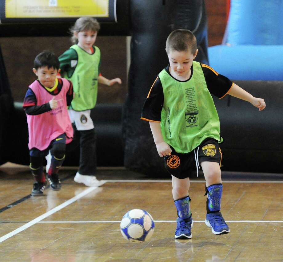 "The Town of Greenwich Department of Parks and Recreation's ""Saturday Indoor Soccer with Aldwin,""  a youth soccer program, at the Greenwich Civic Center, Saturday, Feb. 8, 2014. Photo: Bob Luckey / Greenwich Time"