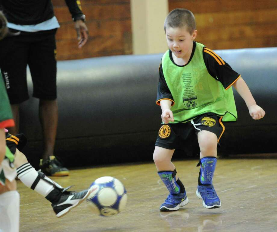 "Brayden Senft, 5, of Greenwich, plays defense during the Town of Greenwich Department of Parks and Recreation's ""Saturday Indoor Soccer with Aldwin,""  a youth soccer program, at the Greenwich Civic Center, Saturday, Feb. 8, 2014. Photo: Bob Luckey / Greenwich Time"