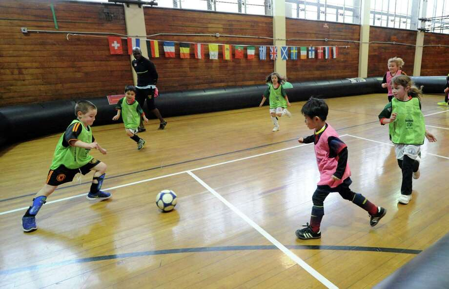 """The Town of Greenwich Department of Parks and Recreation's """"Saturday Indoor Soccer with Aldwin,""""  a youth soccer program, at the Greenwich Civic Center, Saturday, Feb. 8, 2014. Photo: Bob Luckey / Greenwich Time"""