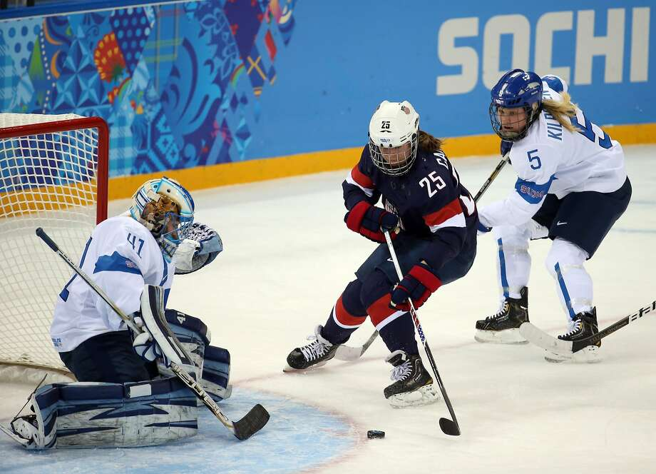 U.S. forward Alex Carpenter (25) looks to score against Finland goalkeeper Noora Raty (41) during the first period. The U.S. won 3-1 against Finland, the bronze medalist in 2010. Photo: Brian Cassella, McClatchy-Tribune News Service