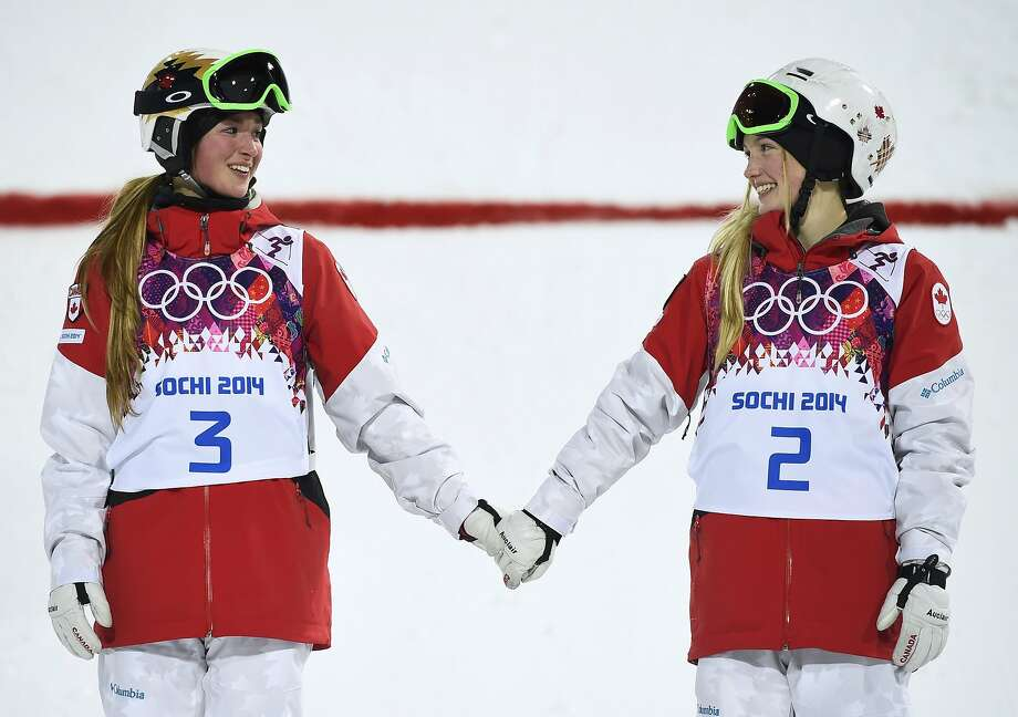 Chloe Dufour-Lapointe (left) won the silver medal and her sister Justine won the gold in the women's freestyle moguls. Photo: Dylan Martinez, Reuters