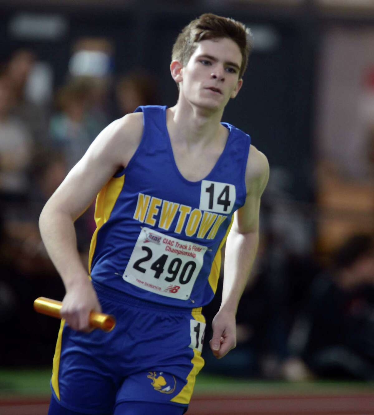 Newtown's Nick Swenson competes in the 4x800 meter relay Saturday, Feb. 8, 2014, during the CIAC Class LL Boys and Girls track championships at the Floyd Little Athletic Center in New Haven, Conn.
