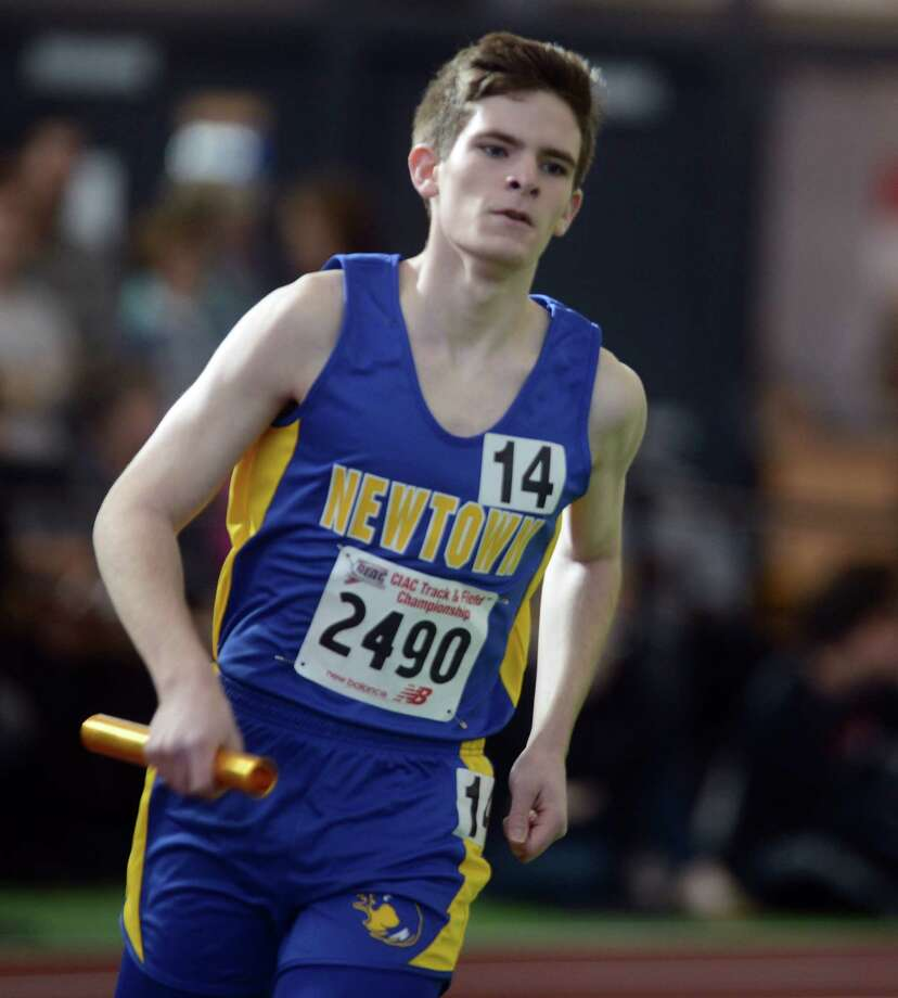 Newtown's Nick Swenson competes in the 4x800 meter relay Saturday, Feb. 8, 2014, during the CIAC Class LL Boys and Girls track championships at the Floyd Little Athletic Center in New Haven, Conn. Photo: Autumn Driscoll / Connecticut Post