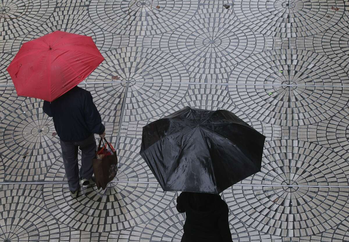 Pedestrians walk in the rain near the Embarcadero Center in San Francisco, Calif. on Saturday, Feb. 8, 2014. The Bay Area is getting doused this weekend in one of the biggest storms in over a year.