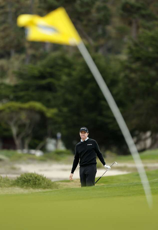 Jimmy Walker tries to gauge the winds approaching the green on the fifth hole. The fierce winds, which moved balls on the greens, caused a delay of more than two hours. Photo: Michael Macor, The Chronicle